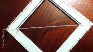 Threads of vissersgaren pulled taut