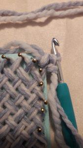 A single crochet in corner A